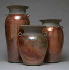 This set of 3 vases was made right in the potters studio in Aug 2012. They each started as a chunk of clay and were made in the round using a potters