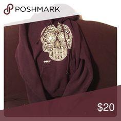 Obey Hoodie Like new (besides the small cut at the neck). Dark purple GLOW IN THE DARK sugar skull hoodie! Obey Tops Sweatshirts & Hoodies