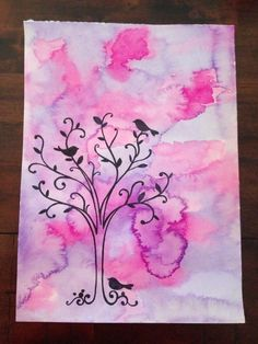 Purple and pink water colour paint with birds and tree silhouette,