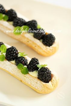dailydelicious: Blackberry eclairs: Your individual fruit pie (pie plating ideas) Fancy Desserts, Just Desserts, Delicious Desserts, Dessert Recipes, Puff And Pie, Food Tech, Choux Pastry, Fruit Pie, Beautiful Desserts