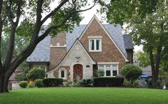 the tudor revival cottage pictured is located in indianapolis indiana usa it features a picturesque combination of stone and brick on its exterior - Brick English Home Plans
