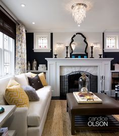 This space was all about striking a balance between traditional and modern. And balancing color was key. Yellow textile accents soften the black and ivory palette, adding a playful attitude. #candiceolson