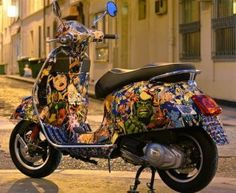 Vespa GTS with comic book wrap. Decoupage, maybe?