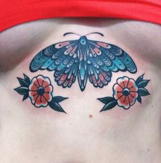 Traditional moth with flowers for underboob, tattooed by swen losinsky, good old times tattoo