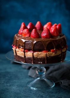 Strawberry Chocolate Cake Recipe on http://twopeasandtheirpod.com This chocolate cake recipe is the BEST! The cake is moist and the chocolate frosting and ganache are divine!