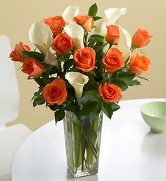 Orange and White floral arrangement    i wonder if a stargazer lilly thrown in would look good?