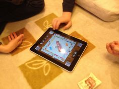 Playing Monopoly by iPad with family.