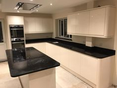Installed A lovely example of the Nero Venata black quartz worktops in this spacious kitchen in Stevenage. Our customer wanted a black quartz worktop with marble effect to enhance the large island and worksurface. Stevenage, Marble Effect, Granite, Kitchen Ideas, Kitchen Cabinets, Home Decor, Decoration Home, Room Decor, Kitchen Cupboards