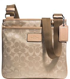 Go everywhere with this cute nude satchel.