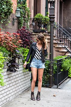 Laura from On the Racks looking cool in a bebe striped bodysuit