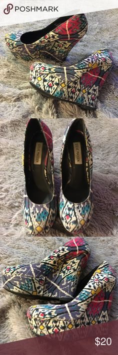 Steve madden colorful platform wedges Worn a handful of times little bit of wear on the bottom but otherwise in good used condition. Colorful print matches just about everything with yellow teal purple cream yellow and gray and black. Very comfortable. Steve Madden Shoes Wedges