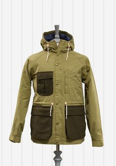 Gant Rugger Wool Pocket Jacket Green | Men of Ilk Wool Pocket Jacket Green £295.00 Gant Rugger Wool Pocket Jacket. Parka style archive piece with contrast wool pockets and drawstring waist. This Jacket also features a two way zip fastening finished in a coated over-constructed twill.