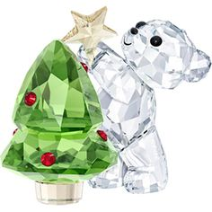 A beloved character from the Swarovski crystal collection, the Annual 2018 Kris Bear figurine celebrates the season by topping a brightly ornamented tree with a brilliant star. dimensions: x x Crystal Wipe clean Imported Swarovski Crystal Figurines, Swarovski Crystals, Swarovski Jewelry, Dog Picture Frames, Christmas Figurines, Crystal Collection, Collectible Figurines, Clear Crystal, Crystal Green