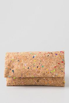 The Lively Cork Clutch features a cork material that has bright specks of color sporadically spread throughout.