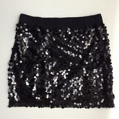 Black Sequins Mini Skirt Black Sequins Mini Skirt with elastic waist band. In gently worn condition = price reduced to reflect its condition. Sequins is all black (picture reflects light), and is an overlay to the lining that is 100% cotton ✨ about 16 inches long Arden B Skirts Mini