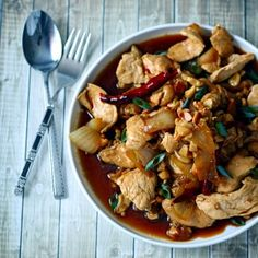 Thai chicken with cashews: soy sauce, sweet soy sauce, fish sauce, brown sugar, water, vegetable or peanut oil, garlic, yellow onion, dried red chilies, roasted cashew nuts, chicken, and spring onion