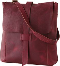 lifetime leather convertible messenger. carry over the shoulder, with a shortened grab handle, or as a backpack. interior pocket has security strap for ipad, two patch pockets.