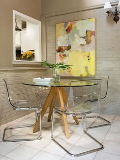 I love this modern, cozy, chic Dining corner. Those lucite chairs are phenomenal.