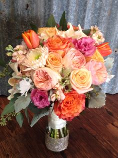 Bridal bouquet shades of coral with sparkly gold
