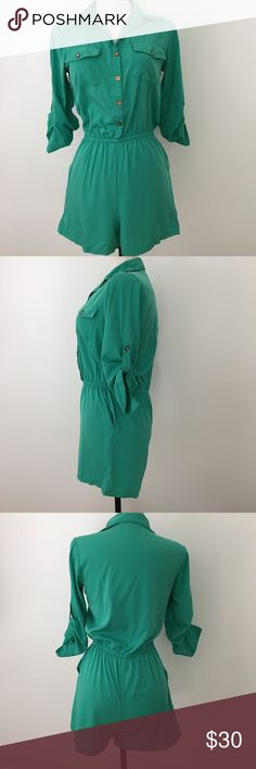 """Emerald green button down romper Speed Control Emerald green button down sexy romper with 4 pockets and 3/4 sleeves and elastic waistband . 100% polyester. Approximate flat measurements: 13"""" waist unstrerched, 18"""" waist fully stretched, 19"""" bust, 12"""" rise of bottom shorts , 20"""" hips, 13"""" thigh width, 14"""" length from waist to bottom hem of leg, 32"""" total length from shoulders to thigh. Great condition. speed control Pants Jumpsuits & Rompers"""