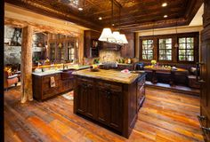 Rustic #kitchen design; love the use of the tin ceiling.