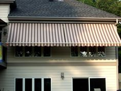 This Hillsborough, NC home is now nicely shaded with two motorized window awnings by http://KellyWindowAndDoor.com/awnings/