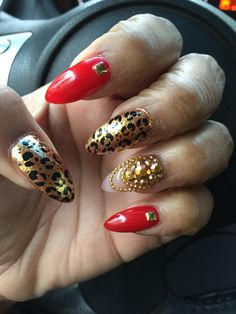 Red and gold cheetah stiletto nails!