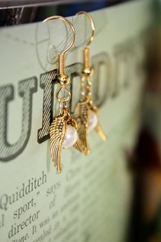 Golden Snitch Pearl Earrings. Yeah, Hubby, next birthday/anniversary/occasion... Gonna need these.