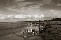 FineArtSeen - Thornham Harbour by Richard Freestone. This limited edition black and white photograph comes from the collection on FineArtSeen. Click to view more art at great prices from the Home Of Original Art. << Pin For Later >>