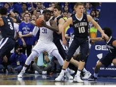 The Xavier player here looks like he is completely loss on what to do with the Villanova defense around him.