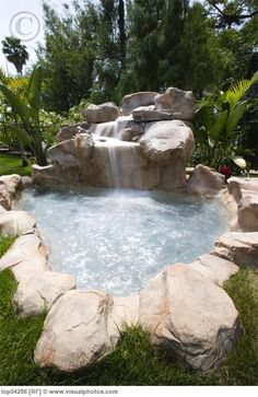 Outdoor jacuzzi with waterfall---This is what I need with no pool