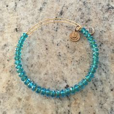 Alex and Ani bracelet This Alex and Ani bracelet is very sweet with the bright blue oblong stones. Alex & Ani Jewelry Bracelets