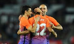 The City defender is surrounded by Jesus Navas (left) and Pablo Zabaleta after scoring with his less favoured right foot