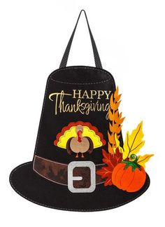 Happy Thanksgiving Pilgrim hat door hanger for your outdoor or indoor decor. Constructed with thick pieces of outdoor safe, polyester blended material that looks and feels like real felt and lightly p