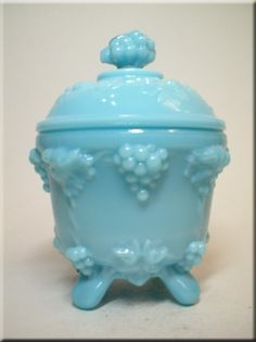 Victorian blue milk glass 'Grape Vine' covered dish, by Portieux, pattern number 6655, shown in 1933 catalogue. This design was later reproduced by Jeannette Glass Co and Indiana Glass.  Ref: The Milk Glass Book p212.