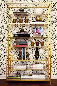<3 gold shelves + awesome wall paper