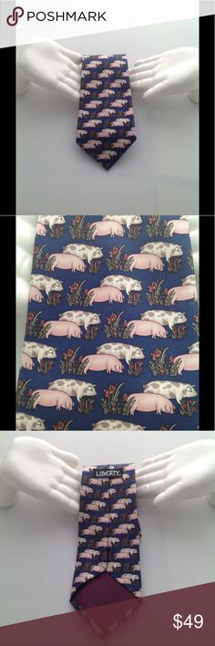 "Rare Vintage Pig Novelty Collector Liberty Tie Vintage...Rare...Novelty...Pig...Tie...Design by Liberty...Very Nice Condition...Print of Pink and Spotted Pigs on a Dark Blue background...Comes from a smoke and pet free home...Thanks for shopping with ""hybridsynergy"" Liberty Accessories Ties"