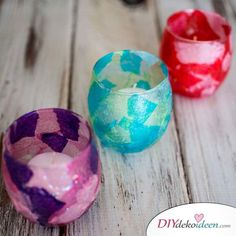 Stained Glass Votive Candle Holders - an easy to make craft using glass candle holders, tissue paper and modpodge that makes a fun holiday gift. Stained Glass Crafts, Faux Stained Glass, Glass Votive Candle Holders, Votive Candles, Glass Holders, Tissue Paper Crafts, Diy Paper, Christmas Candles, Christmas Centerpieces