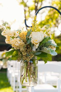 #aisle-decor, #mason-jars  Photography: Heather Scharf Photography - heatherscharfphotography.com Floral Design: Blossoms by Lisa - blossomsbylisa.wordpress.com/about  Read More: http://www.stylemepretty.com/california-weddings/lodi/2012/07/11/lodi-wedding-at-wine-roses-by-heather-scharf-photography/