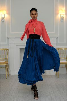 Cobalt long full skirt with the pleat-effect of broomstick crinkle. Worn with a black obi belt and tie-neck bright coral top. Juan Carlos Obando Fall 2013 Ready-to-Wear