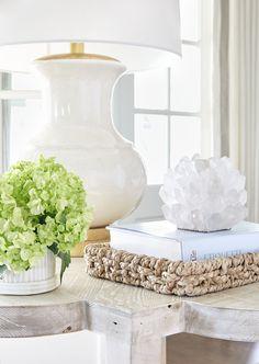 The Highlands – Sarah Bartholomew | white on white vignette with white porcelain lamp and quartz | beautifully styled side table