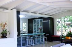 Elegant modern kitchen with glass door refrigerator next to beautiful Wenge cabinets - Decoist