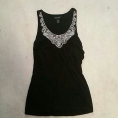 Embroidered tank top Fitted black tank top, with gold embroidery. Has a built-in bra. White House Black Market Tops Tank Tops