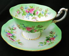 ROYAL-ALBERT-RAINBOW-GRAND-PEDESTAL-TEA-CUP-AND-SAUCER-MOSS-ROSE