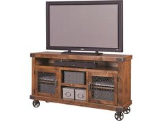 """Vintage industrial style and modern function join forces in this 65"""" console. The piece is perfectly sized for your flatscreen, with ample open shelving, including a soundbar area to set up your media consoles. Metal accents like caster wheels, wire door fronts, and metal brackets combine with a rustic finish to create an authentic industrial look and feel."""
