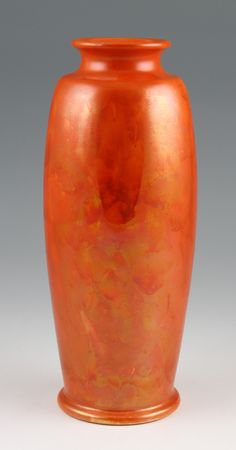 Antiques auction - A Ruskin pottery vase with a matt orange lustre glaze finish. Stunning piece of English studio pottery by the infamous Ruskin Pottery company. Estimate £80 - £120. For all bidding information visit our website http://www.biddleandwebb.com