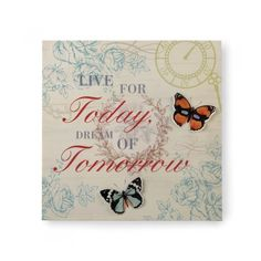 LIVE AND DREAM 3-D BUTTERFLY WALL ART Wise words have never looked so pretty! This iron wall art features two beautiful butterflies with cutout wings on a floral background, and the phrase reads Live for Today, Dream of Tomorrow.  Materials: IRON