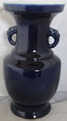 "Chinese baluster porcelain vase covered with a monochrome cobalt blue glaze,two monster head handles at the neck. Qing Dynasty. 19th Century. 15"" height."