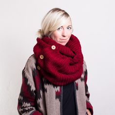 This is the most versatile scarf you will own, not only can you button up and loop it around your neck like a snood, but you can also unbutton the end