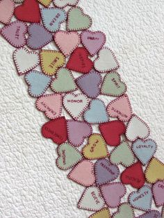 Valentine candy hearts sewing project. Wool applique pattern to make a 10 1/2 x 41 reversible table runner. Color choices are up to you!